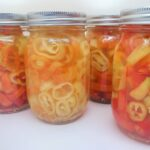 pickled banana pepper rings in four mason jars