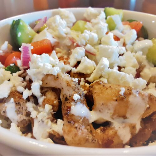 greek chicken and rice bowl with feta cheese