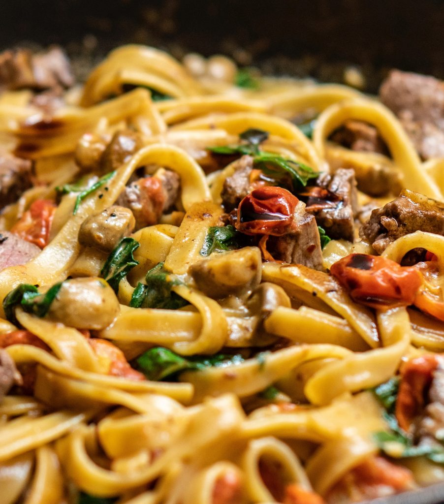 creamy tuscan chicken pasta sauce recipe with tomatoes and mushrooms