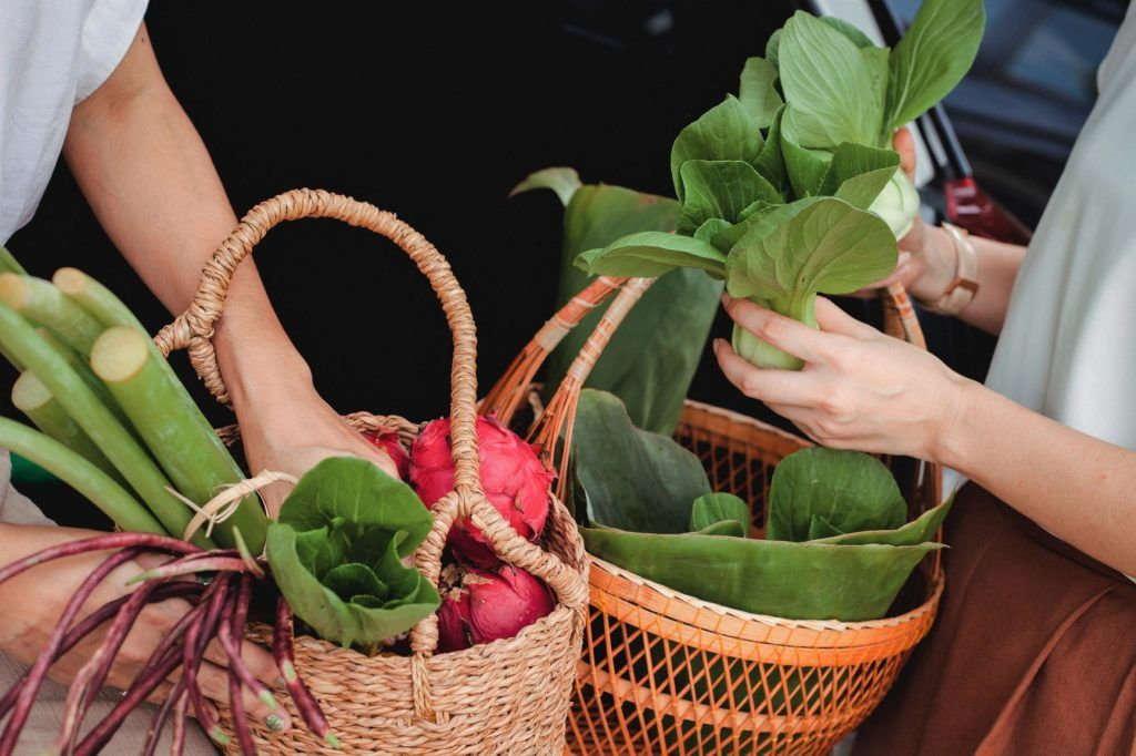 winter asian vegetables and leafy greens in baskets